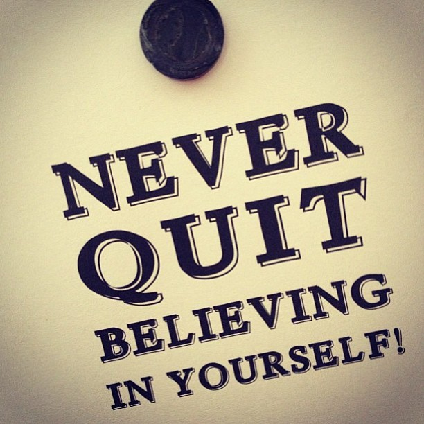 "Post-it note with text that says ""Never Quit Believing in yourself"""