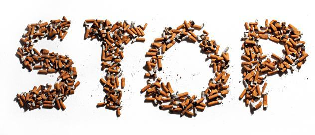 cigarette butts that spell out the word STOP in capital letters