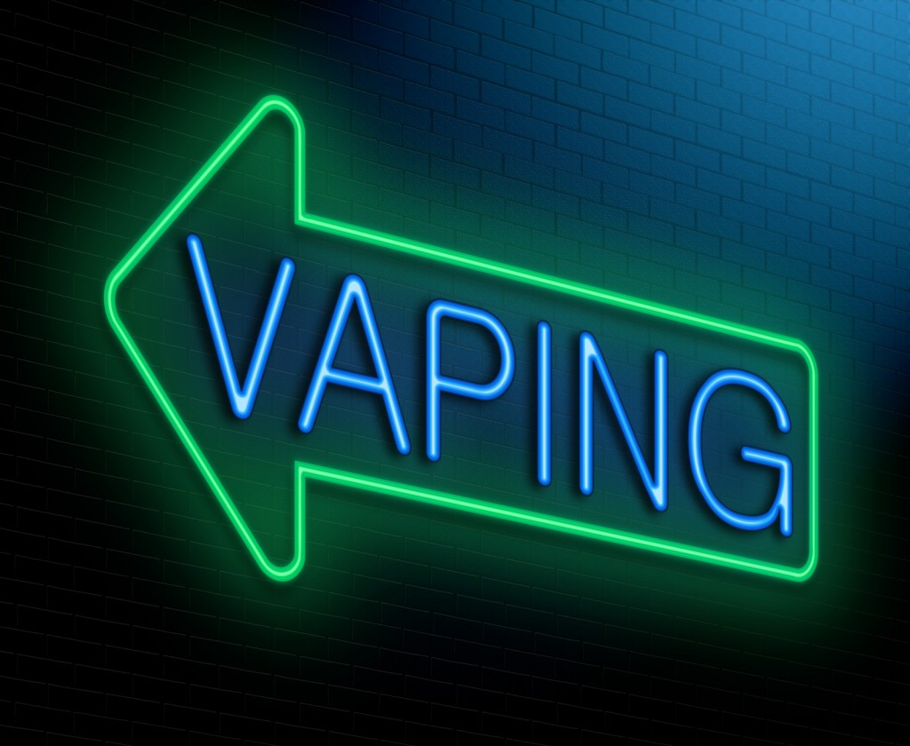 Neon light of an arrow with the text Vaping side